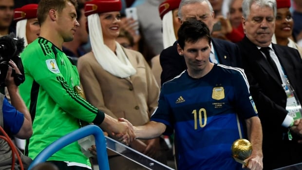 Lionel Messi, right, appears dejected as he shakes the hand of Germany's Manuel Neuer during the FIFA World Cup awards ceremony in Brazil.