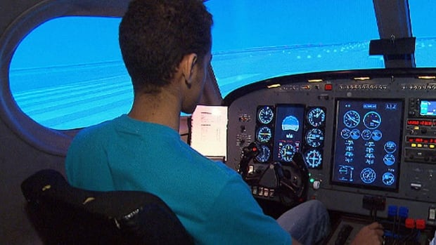 A student at a St-Hubert flight school uses the simulator as part of his training.