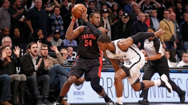 Toronto Raptors forward Patrick Patterson holds the ball after stealing it from Brooklyn Nets guard Joe Johnson during a Jan. 27 game.