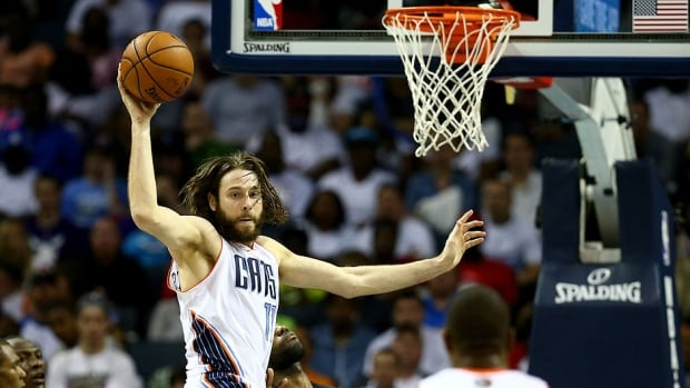 """In Josh McRoberts, left, Heat president Pat Riley says the team is """"delighted that this multi-faceted player will help us immensely."""" McRoberts finalized a four-year free-agent deal with Miami on Monday along with fellow forward Danny Granger (two years)."""