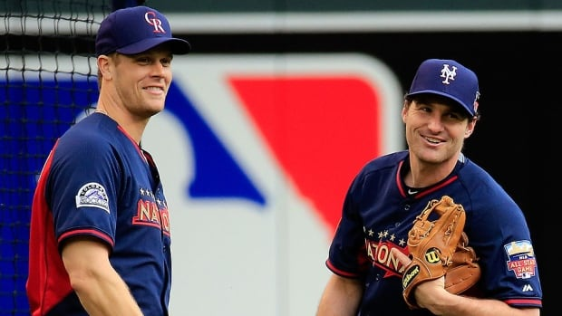 Canadian first baseman Justin Morneau, left, of the Colorado Rockies, shares a laugh with Daniel Murphy of the New York Mets prior to participating in Monday night's Home Run Derby in Minnesota. Rockies teammate Troy Tulowitzki, who was captain of the NL Derby squad, said it was an easy choice picking Morneau for the event.