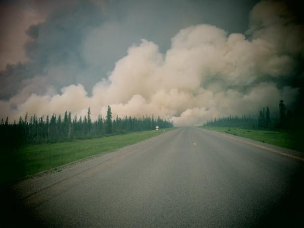 Smoke billows over Highway 3