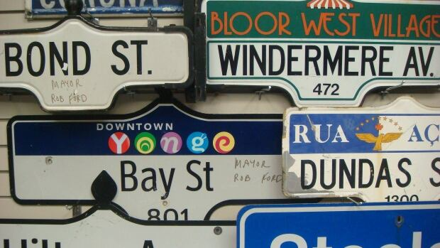 The mayor's signature brought in high bids on the city's street sign auctions.