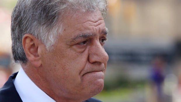 Former M.P. and London Mayor, Joe Fontana, walks to the London, Ont., courthouse for sentencing in his fraud trial Tuesday July 15, 2014.