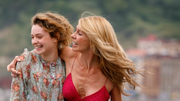 Argentinian actresses Martina Juncadella and Silvia Perez laugh together. A study published on Monday found that people are apt to pick friends who are genetically similar to themselves — so much so that friends tend to be as alike at the genetic level as a person's fourth cousin.