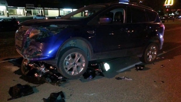 A woman was hospitalized after her motorbike was hit by this SUV in Regina.