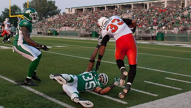 Andrew Harris (33) of the Lions breaks a tackle for a touchdown in Saturday's 26-13 victory over the Roughriders at Regina.