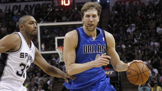 Dirk Nowitzki, right, has signed a three-year, $30 million US contract to remain with the Mavericks. The 36-year averaged 21.7 points and 6.2 rebounds in 80 games last season.