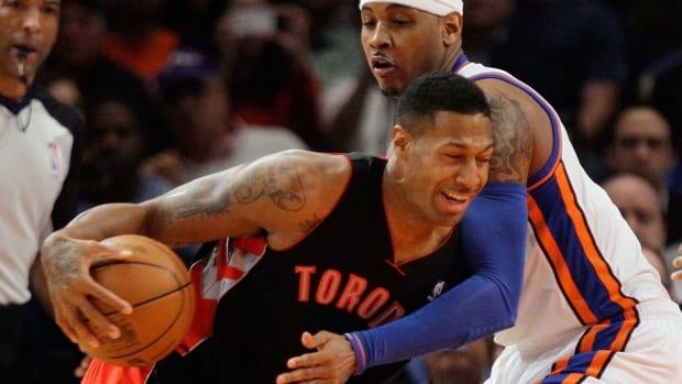 Forward James Johnson, left, seen here with Raptors in March 2012, is back with Toronto on a two-year deal. Johnson, who spent parts of the 2010-11 and 2011-12 seasons with the Raptors, had issues seeing eye-to-eye with head coach Dwane Casey but says they have moved past any differences.