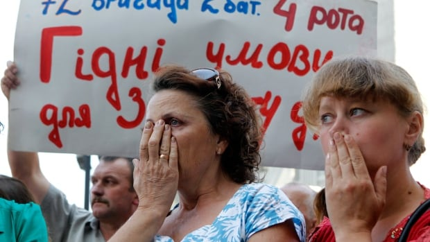 People attend a rally demanding support for the Ukrainian army in the military operation against separatists in front of the presidential administration headquarters in Kyiv on Wednesday.