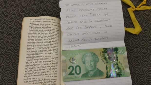 Inside the book staff found a handwritten note and five new $20 bills to cover the overdue fine.
