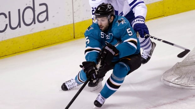San Jose Sharks defenceman Jason Demers battling Toronto in a game in March.