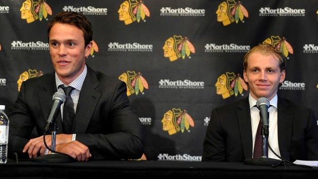 Chicago Blackhawks players Jonathan Toews, left,  and Patrick Kane smile during a news conference at the United Center in Chicago on Wednesday.