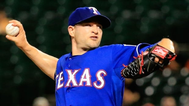 Veteran reliever Jason Frasor, pictured here, is headed to Kansas City in a trade from the Rangers in exchange for triple-A right-hander Spencer Patton. Frasor was 1-1 with a 3.34 ERA in 38 appearances this season, his second in Texas.