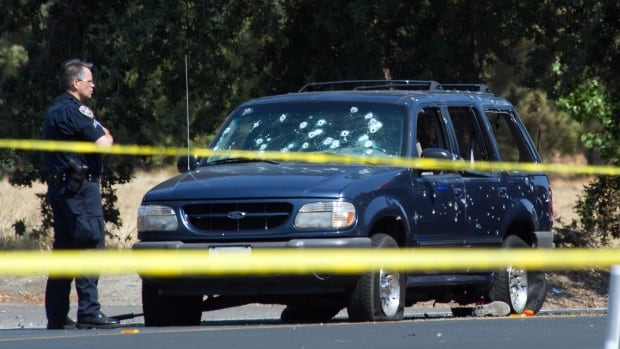 Cars and houses were riddled with bullets during a high-speed chase and hostages were thrown from a fleeing SUV after a California bank robbery Wednesday that led to the deaths of a hostage and two robbers, police said.