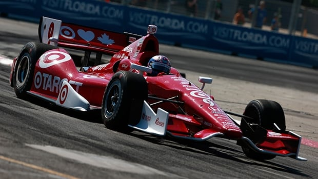 Scott Dixon of Target Racing negotiates a turn en route to winning the Honda Indy Toronto at Exhibition Place on July 14, 2013.