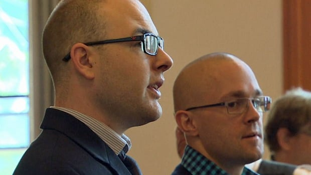 Ben Strongitharm (left) and Peter Blok-Andersen (right) wait for their sentencing hearing to begin at Newfoundland and Labrador Supreme Court in St. John's.
