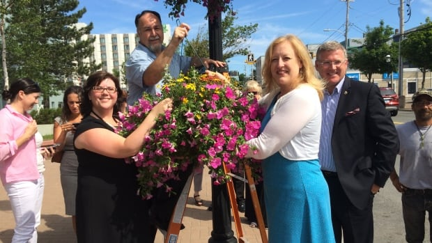 Sydney business people and politicians hung 100 flower baskets in the downtown.