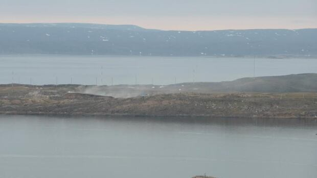 Iqaluit's dump sits on a spit of land in Frobisher Bay in full view of the city of about 7,000. It's been on fire for two months today.