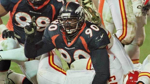 Defensive lineman Neil Smith, seen with the Denver Broncos in a 1998 game, is one of the players involved in the latest legal action by former NFLers.