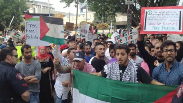 Calgary police has to call in extra forces to deal with the large crowds at the Israel-Palestine conflict protest in July.