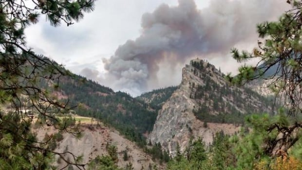 An aggressive wildfire burning north of Lytton consumed a barn Friday. About 45 residents have been told to leave their homes.