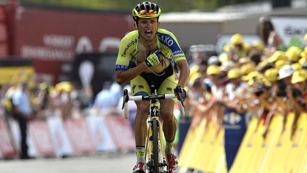 Poland's Rafal Majka celebrates as he crosses the finish line at the end of the 177-km 14th stage of the Tour de France Saturday.