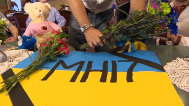 A small group of Dutch and Ukrainian Canadians gathered in Edmonton to mourn the 298 victims killed when Malaysian Airlines Flight MH17 crashed in Ukraine.