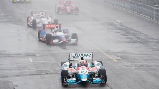 Canada's James Hinchcliffe (27) drives under a yellow caution flag during slippery conditions ahead of the first race of a weekend doubleheader at the Toronto Indy on Saturday.