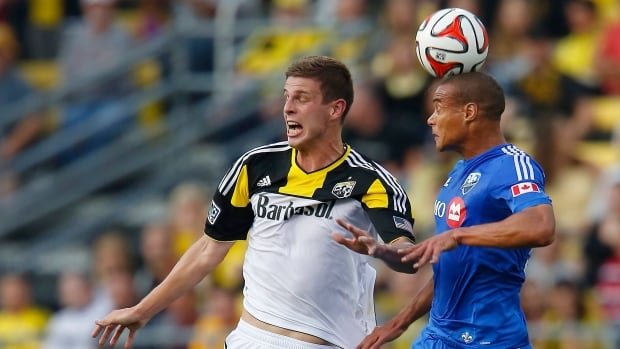 Columbus Crew forward Adam Bedell (left) heads the ball with Montreal Impact defender Matteo Ferrari (right) during the first half on Saturday.