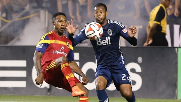 Real Salt Lake forward Robbie Findley (10) kicks the ball over Vancouver FC defender Carlyle Mitchell (24) during the second half at Rio Tinto Stadium on Saturday.