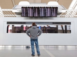 Passenger looking at status of flights on board at Pearson airport