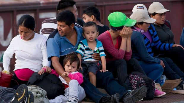 Central American migrants ride a freight train during their journey toward the U.S.-Mexico border in Ixtepec, Mexico. The number of family units and unaccompanied children arrested by U.S. border patrol in the Rio Grande Valley has doubled in the first nine months of this fiscal year compared to the same period last year.