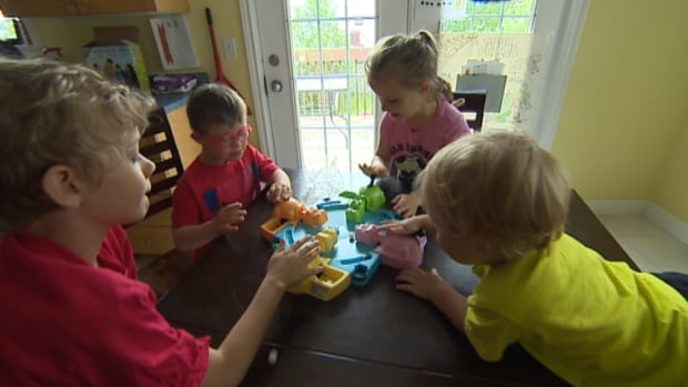 Ian, Eric, Emme and Evan Outhouse all play Hungry Hungry Hippos. Emme is enrolled in the IWK's EIBI program. Her parents hope to get two-year-old Evan into the program as well.