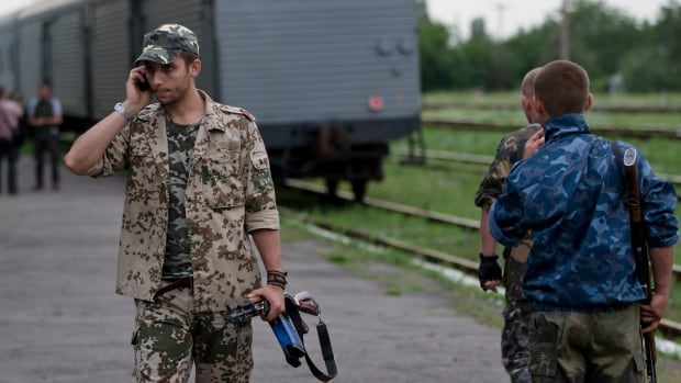A pro-Russian rebel speaks on the phone in eastern Ukraine earlier this month. Comments posted on Russian social networking sites before the wreck of flight MH17 was positively identified may have inadvertently provided proof the rebels were responsible.