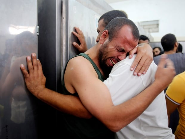 Palestinians mourn the death of their relatives, whom medics said were killed in shelling, at a hospital morgue in Rafah in the southern Gaza Strip on July 21, 2014. Israeli tanks shelled targets in the Gaza Strip on Monday after the bloodiest day of a nearly two-week military offensive that showed no signs of abating, despite global calls for a truce.