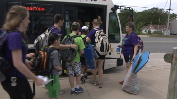 Children from the Ben James Summer Camp climb aboard a Halifax Transit bus. The camp is charged every time they want to travel.