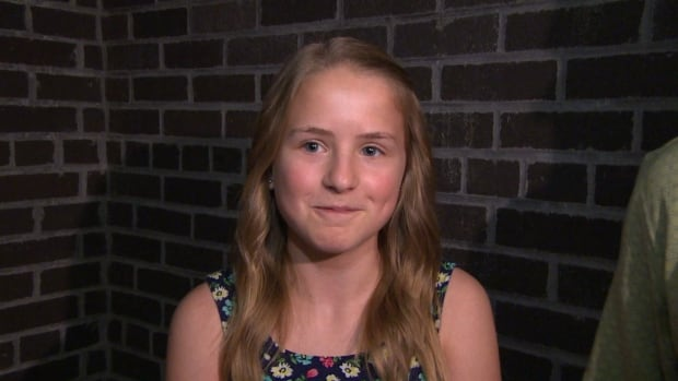 Andrea Warzel, 14, received the Winnipeg Fire Paramedic Service Citizen Recognition Award today for remaining calm when her dad collapsed in June, calling 911 and relaying instructions to her mother who was performing CPR.