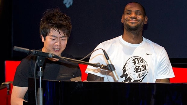 NBA basketball star LeBron James, right, plays piano with renowned pianist Lang Lang of China, left, during a Nike-sponsored event in Beijing.