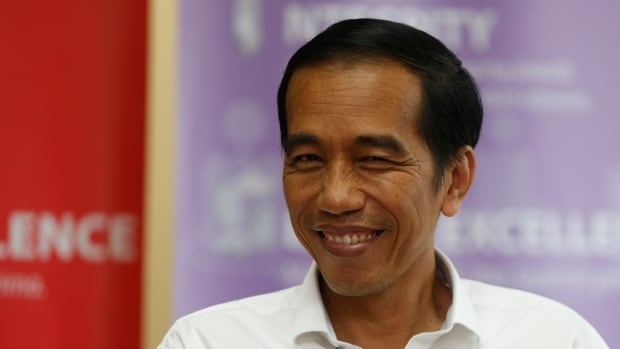 Indonesia's presidential candidate Joko Widodo smiles during a talk with his supporters at the Bisnis Indonesia newspaper office in Jakarta on Monday.