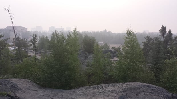 Smoke from over 200 forest fires lingers in the air in downtown Yellowknife around 6:30 MT July 22. The city has gone past 10 out of 10 on the Air Quality Health Index published by a coalition of government monitoring agencies.