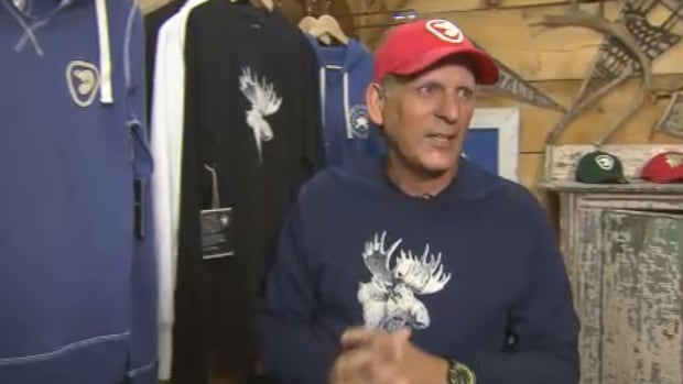 Designer Roger Edwards shows off the beaver logo and moose design on a line of merchandise for Parks Canada.