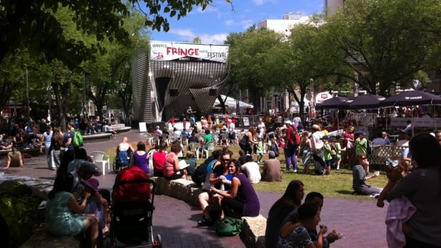 Winnipeg Fringe Festival-goers take in a lunch-hour performance by local band Sc Mira at The Cube in Old Market Square July 23. The fest broke previous attendance records, with over 104,000 people taking in shows.