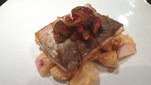 Mike Green's barecued Arctic char on a bed of spicy potato salad with pickled cucumbers.