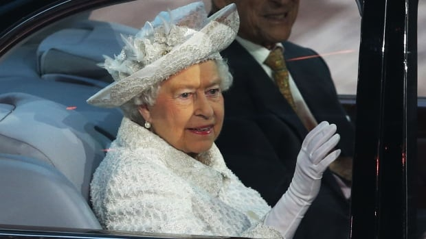 Queen Elizabeth II waves to the crowd as she arrives at the 2014 Commonwealth Games in Glasgow.