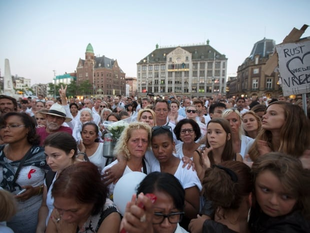 ukraine-crisis-netherlands-mh17-victims-vigil - Prayer for Flight MH17 - Philippine Business News