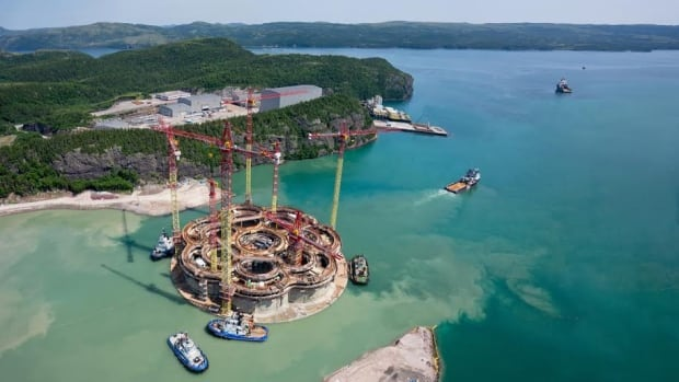 The Hebron gravity based structure (GBS) is towed to the deepwater construction site at Bull Arm.