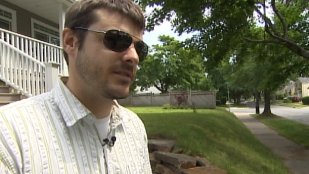 Michael Smith says city contractors have yet to fix his retaining wall, which was damaged by a snow plow.