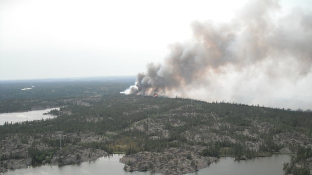 An aerial view of a forest fire near the high-voltage power transmission line between Behchoko and the Snare hydroelectric plant that caused outages in Yellowknife, Behchoko and Dettah on Tuesday.