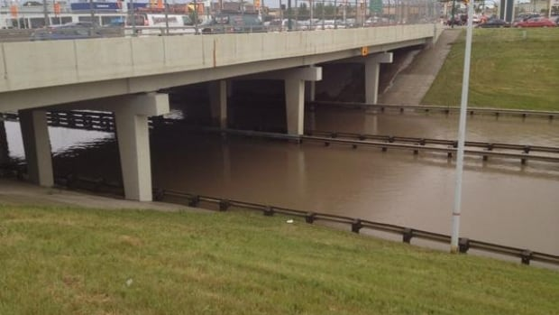 An underpass in Saskatoon, at the Idylwyld Freeway, filled with water in the storm.